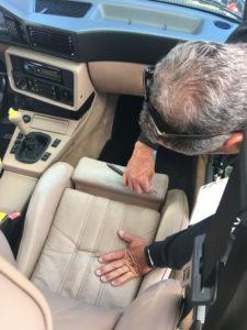 Man restoring car upholstery.