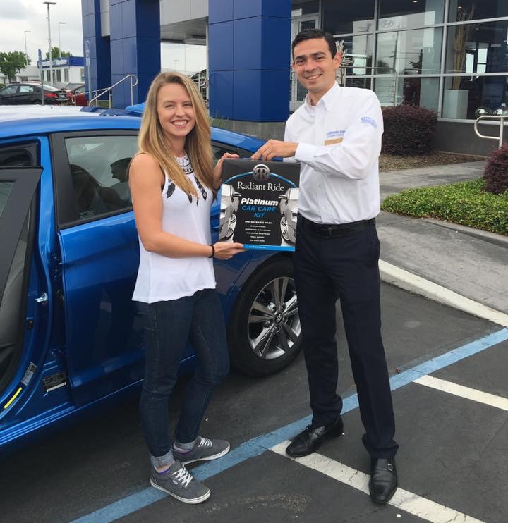 Young woman receiving her Radiant Ride Platinum Car Care Kit